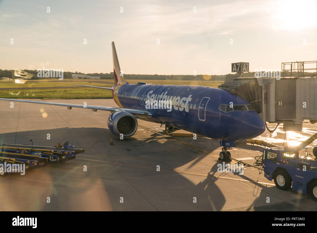 New York, USA - Circa 2018: Southwest airlines Boeing 737 airplane at terminal gate boaring passengers for early morning flight departure Stock Photo