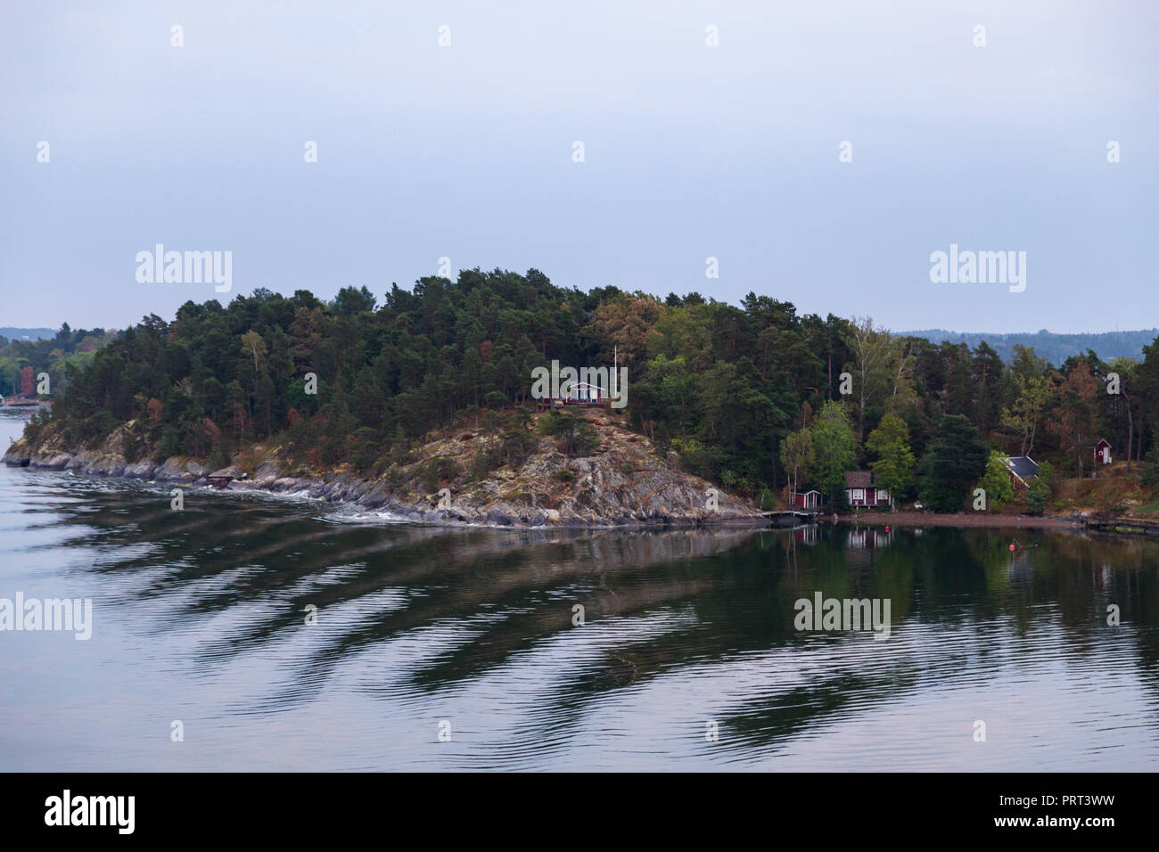 Houses and cottages in quiet Stockholm Archipelago with colorful trees, Stockholm Sweden - Stock Image