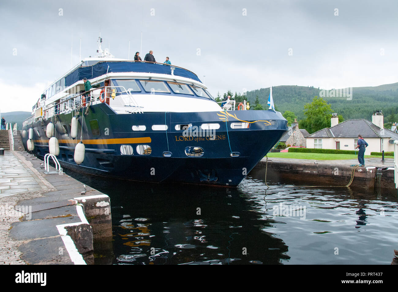 Lord of the Glens pleasure cruiser coming through the narrow lock on the Caledonian canal at Fort Augustus, Scotland - Stock Image