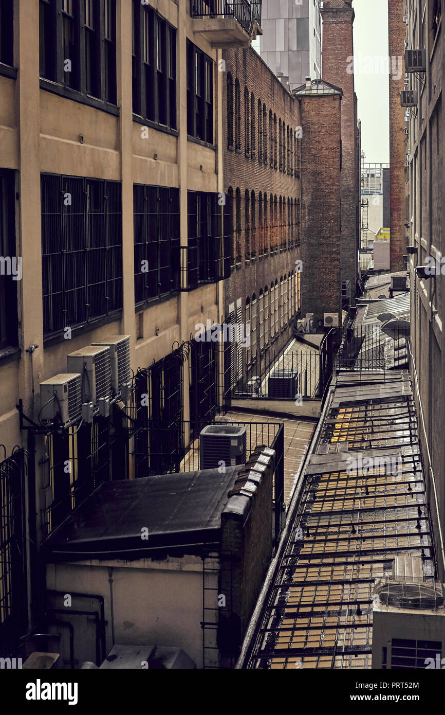 Retro toned old industrial buildings in New York on a rainy day, USA. - Stock Image
