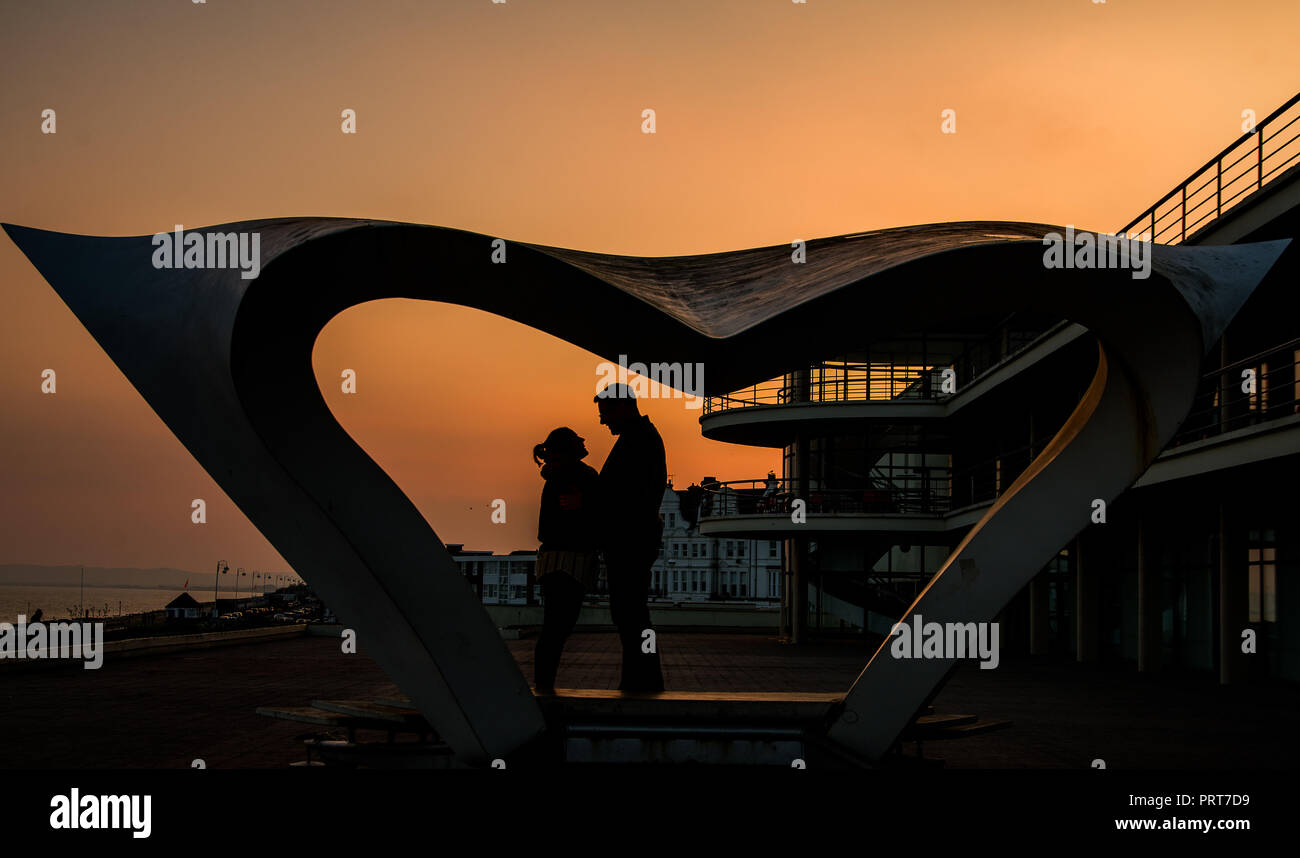 Sunsets and people - Stock Image