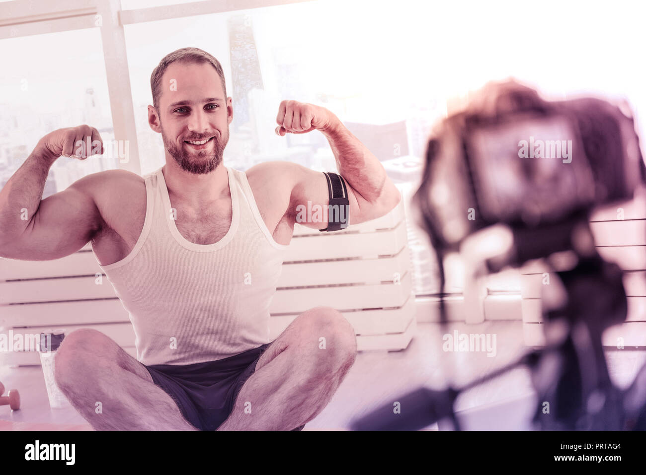 Strong sportsman exposing his muscle for camera Stock Photo