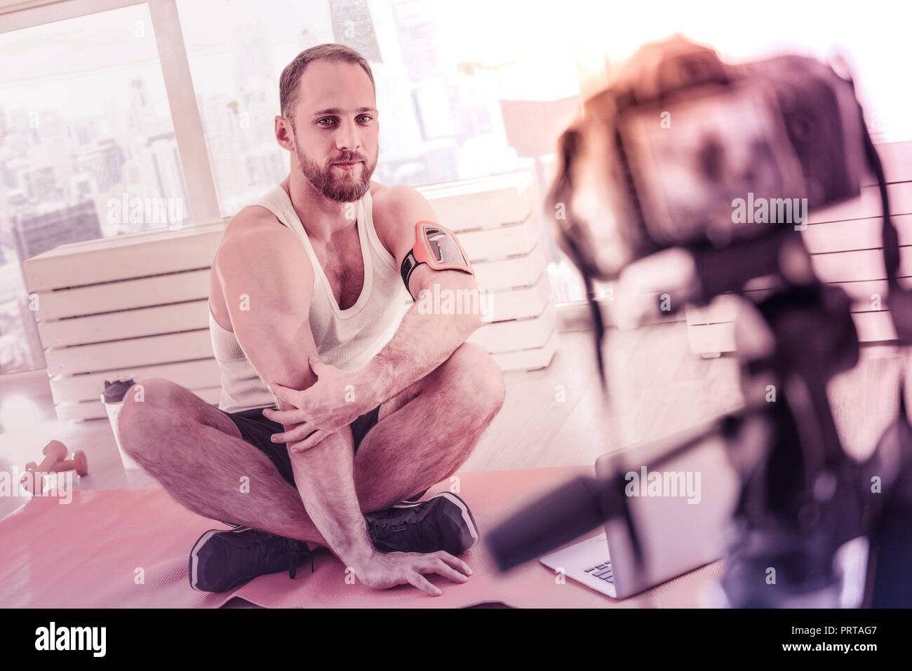 Charismatic sportive man posing in front of camera Stock Photo