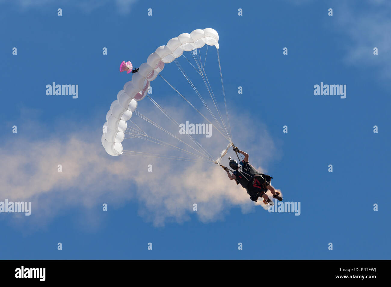 Australian adventurer and wing suit flyer Rex Pemberton parachutes to earth after a wing suit flight. - Stock Image