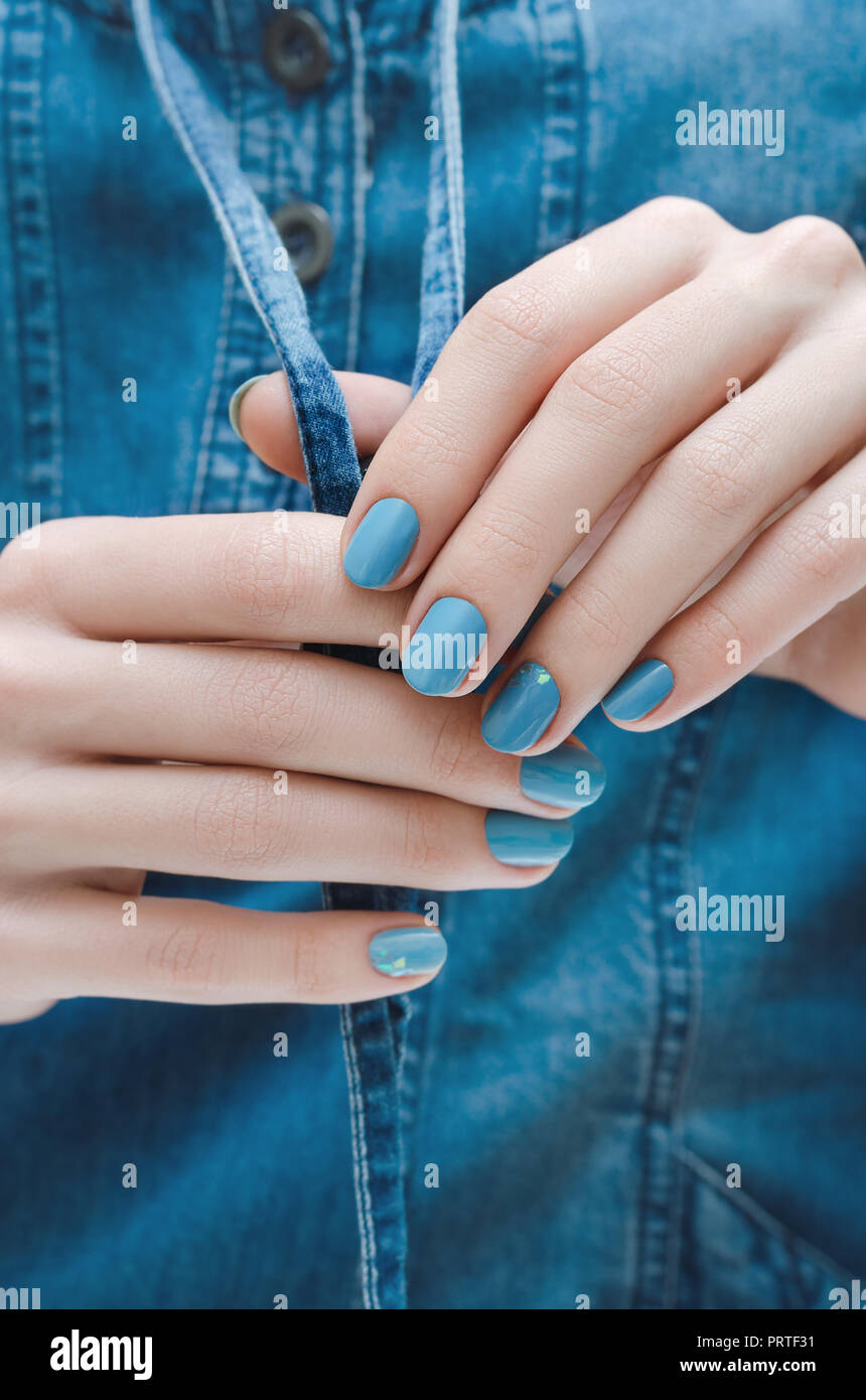 Beautiful Female Hand With Blue Nail Design Stock Photo 221200197