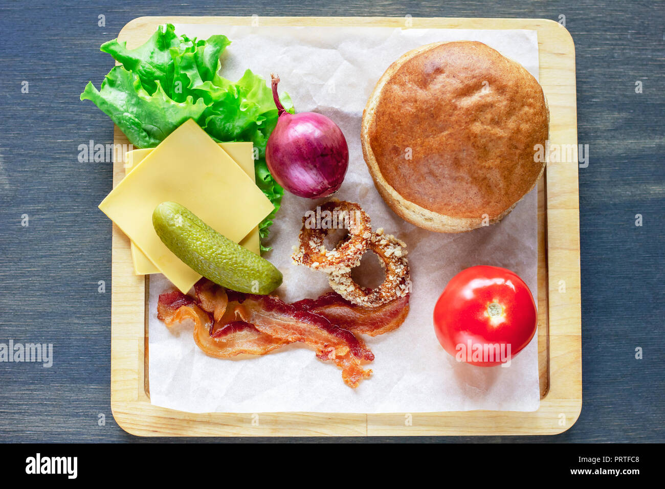 Ingredients for Burger bun, onion, lettuce, tomato, bacon and ot Stock Photo