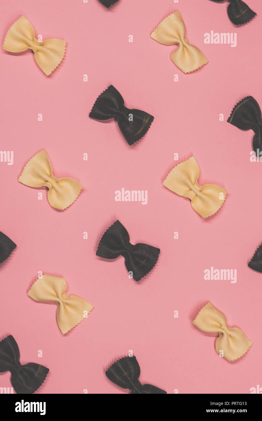 White and black pasta farfalle lies diagonally - Stock Image