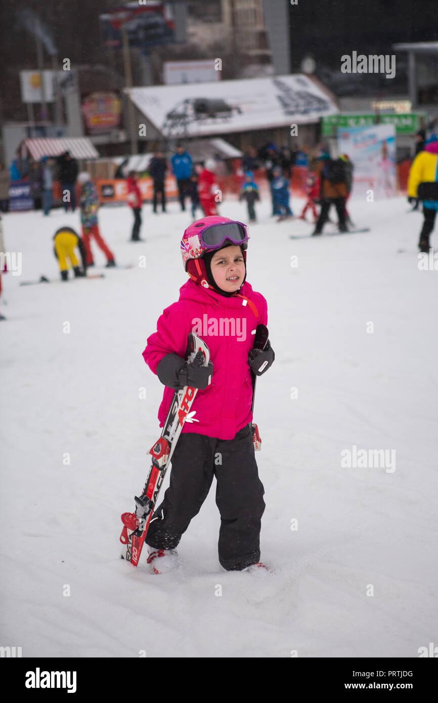 Ukraine, Kiev ski resort Protasov Yar January 25, 2015. The ski slope in the city center. Ski school for children. The instructor teaches a group of p - Stock Image