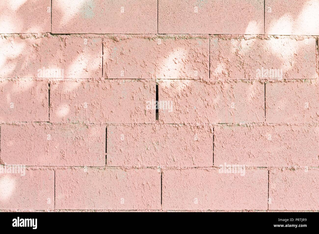 Pink brick wall background (Marche, Italy, Europe) - Stock Image