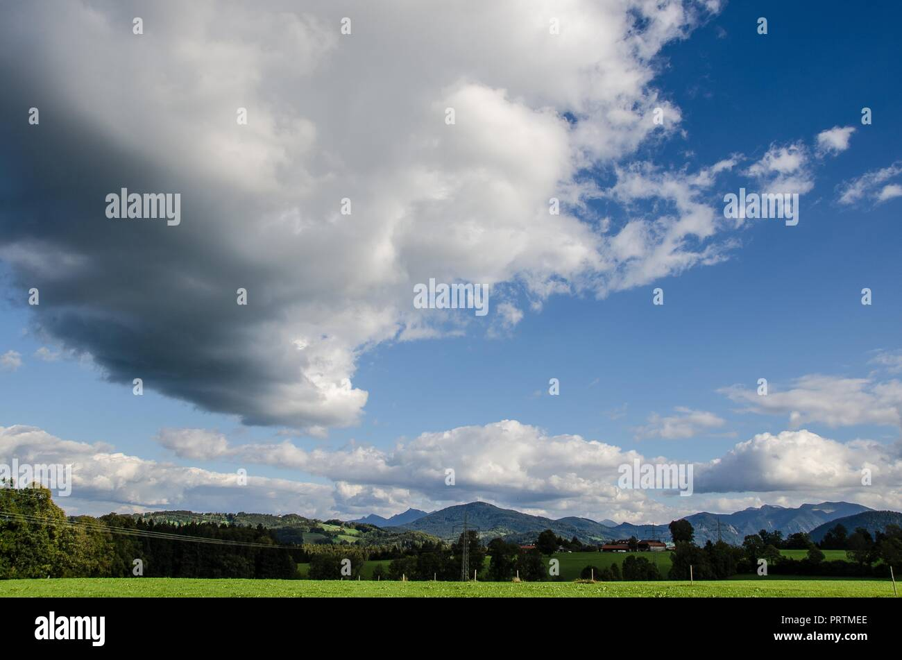 Clouds over the Bavarian Alps - Clouds are given different names based on their shape and their height in the sky. - Stock Image