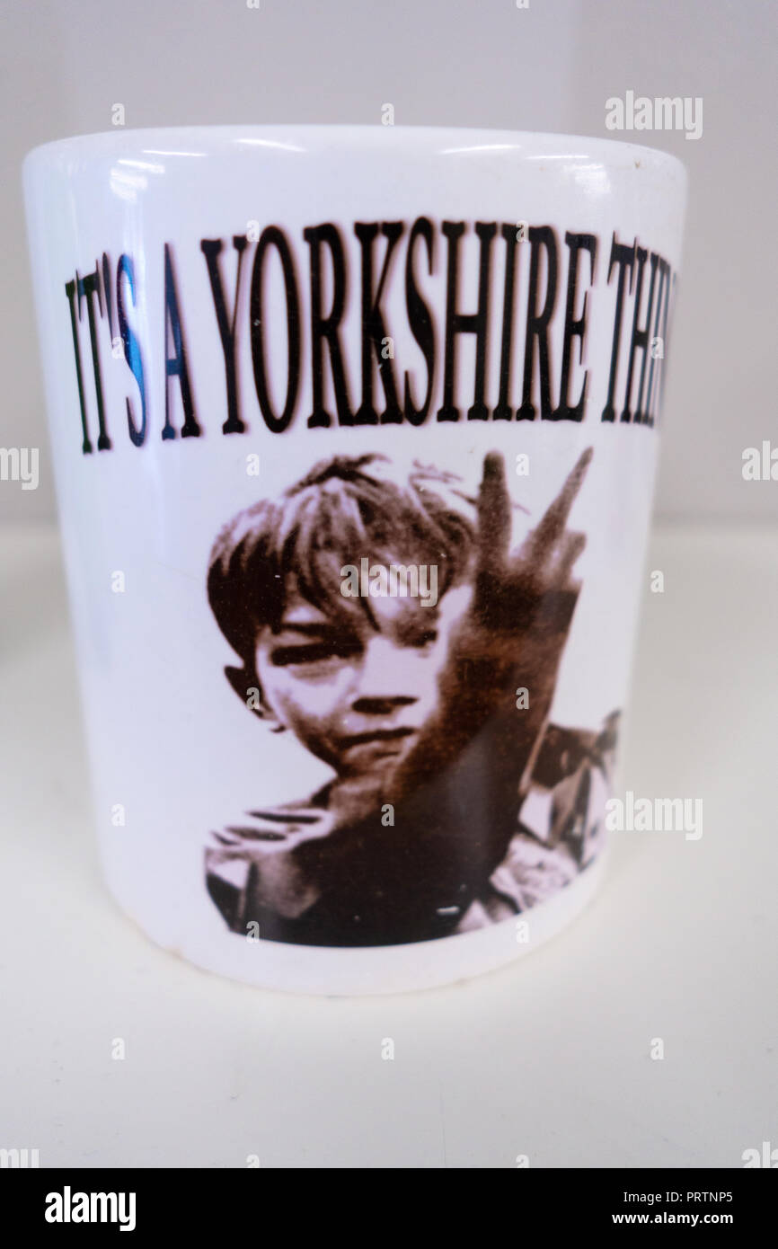 Two Fingers It's a Yorkshire Thing, Mug showing David 'Dai' Bradley when he played Billy Casper in the 1969 film Kes - Stock Image