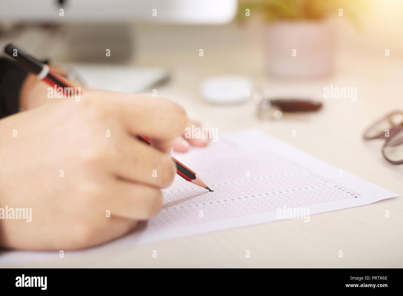 Picture of fill omr sheet with pencil. - Stock Image
