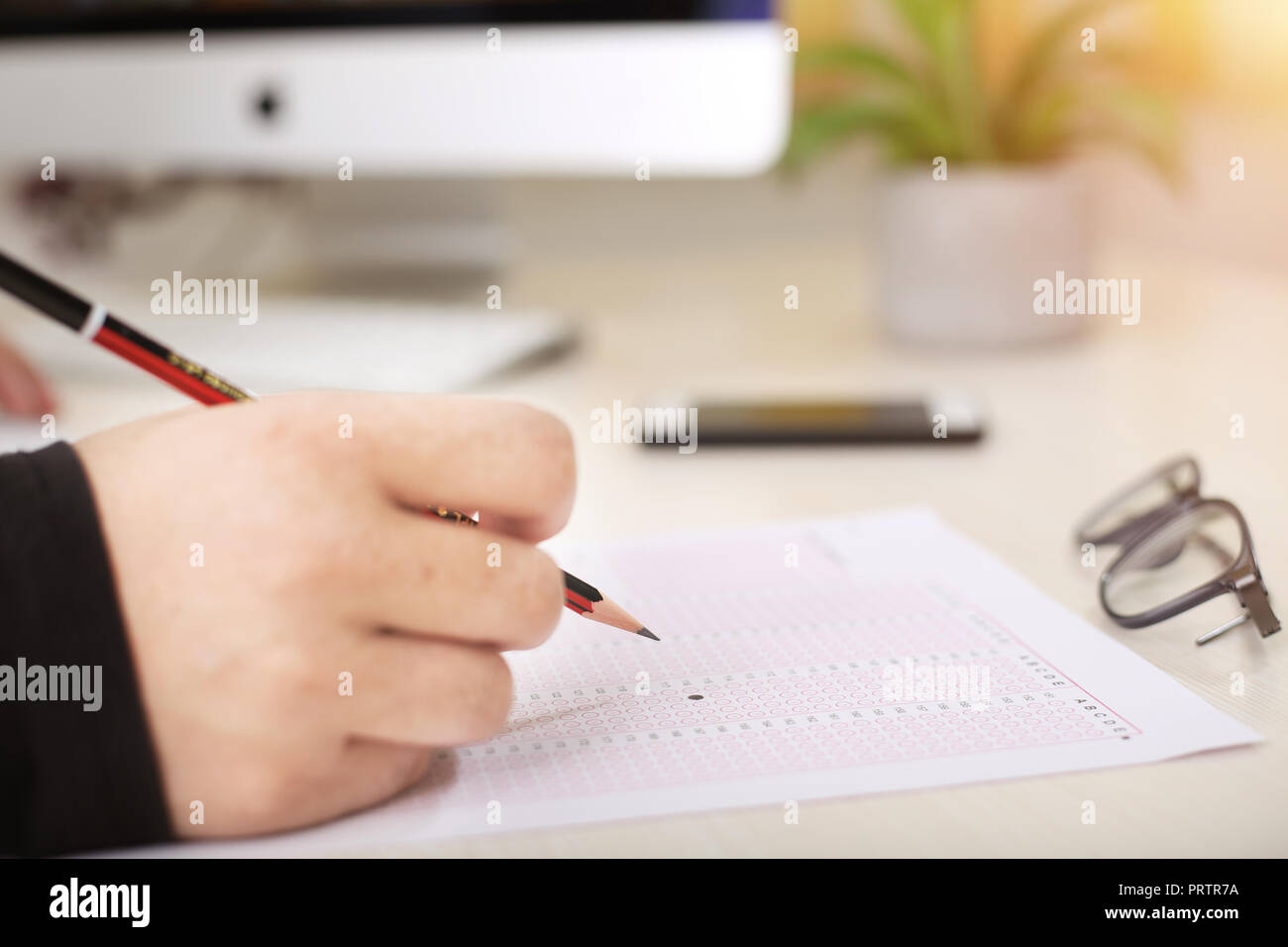 Exam omr sheet with pencil and glasses. - Stock Image