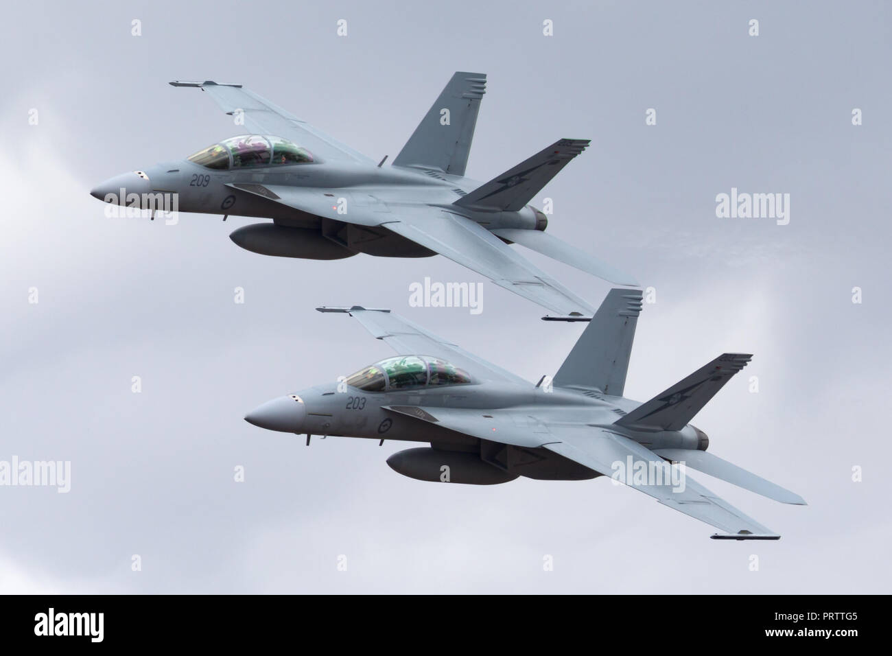 Two Royal Australian Air Force (RAAF) Boeing F/A-18F Super Hornet multirole fighter aircraft flying in formation. - Stock Image