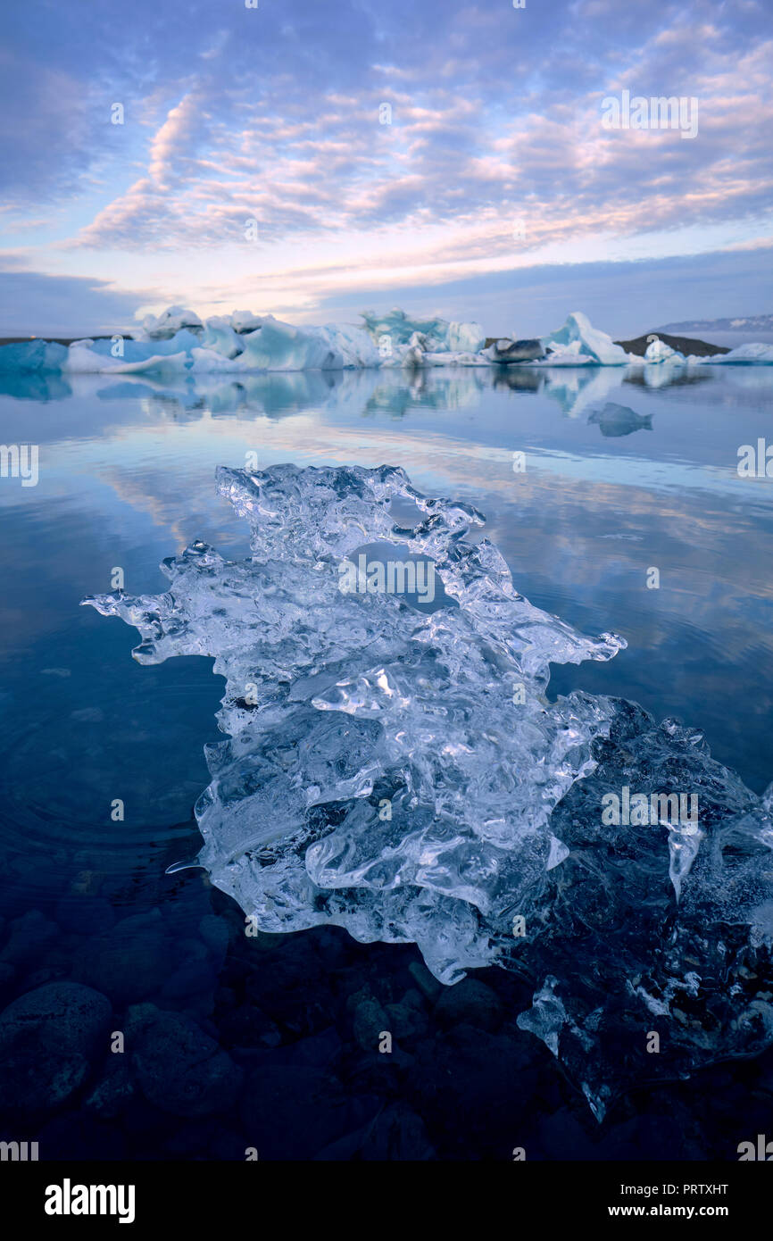 Melting ice and icebergs in the glacier lagoon at Jokulsarlon in south east Iceland. - Stock Image