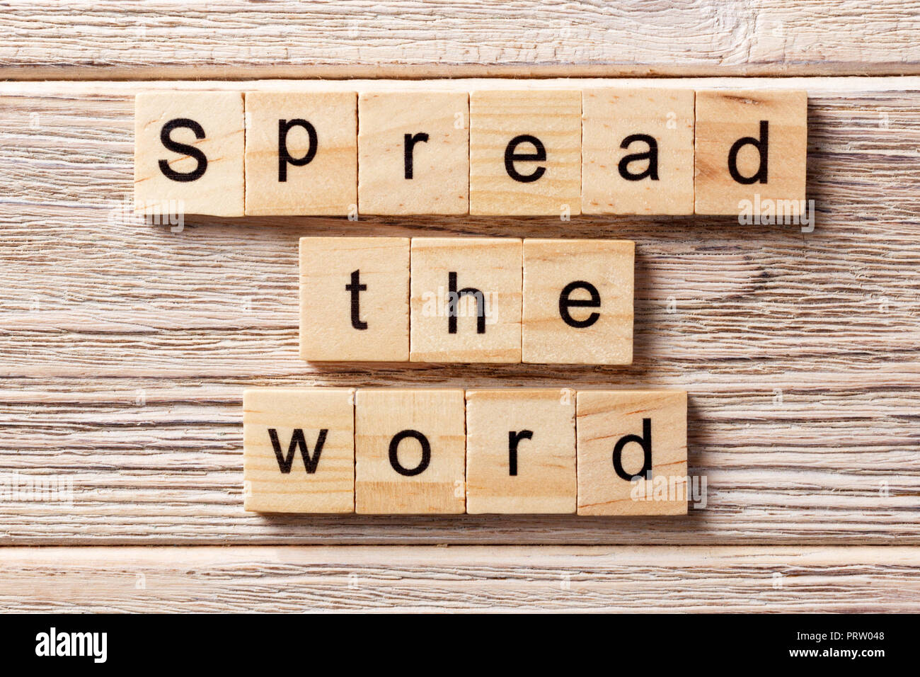 Spread the word word written on wood block. Spread the word text on table, concept. - Stock Image