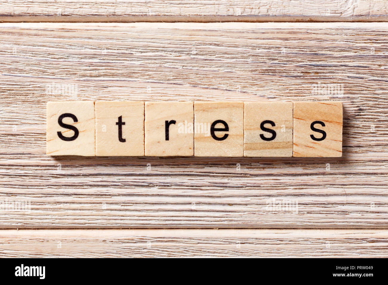 Stress word written on wood block. Stress text on table, concept. - Stock Image