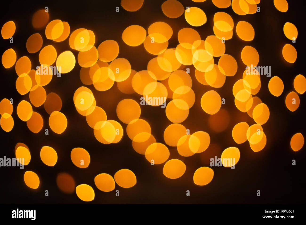 unfocused yellow Christmas light - Stock Image