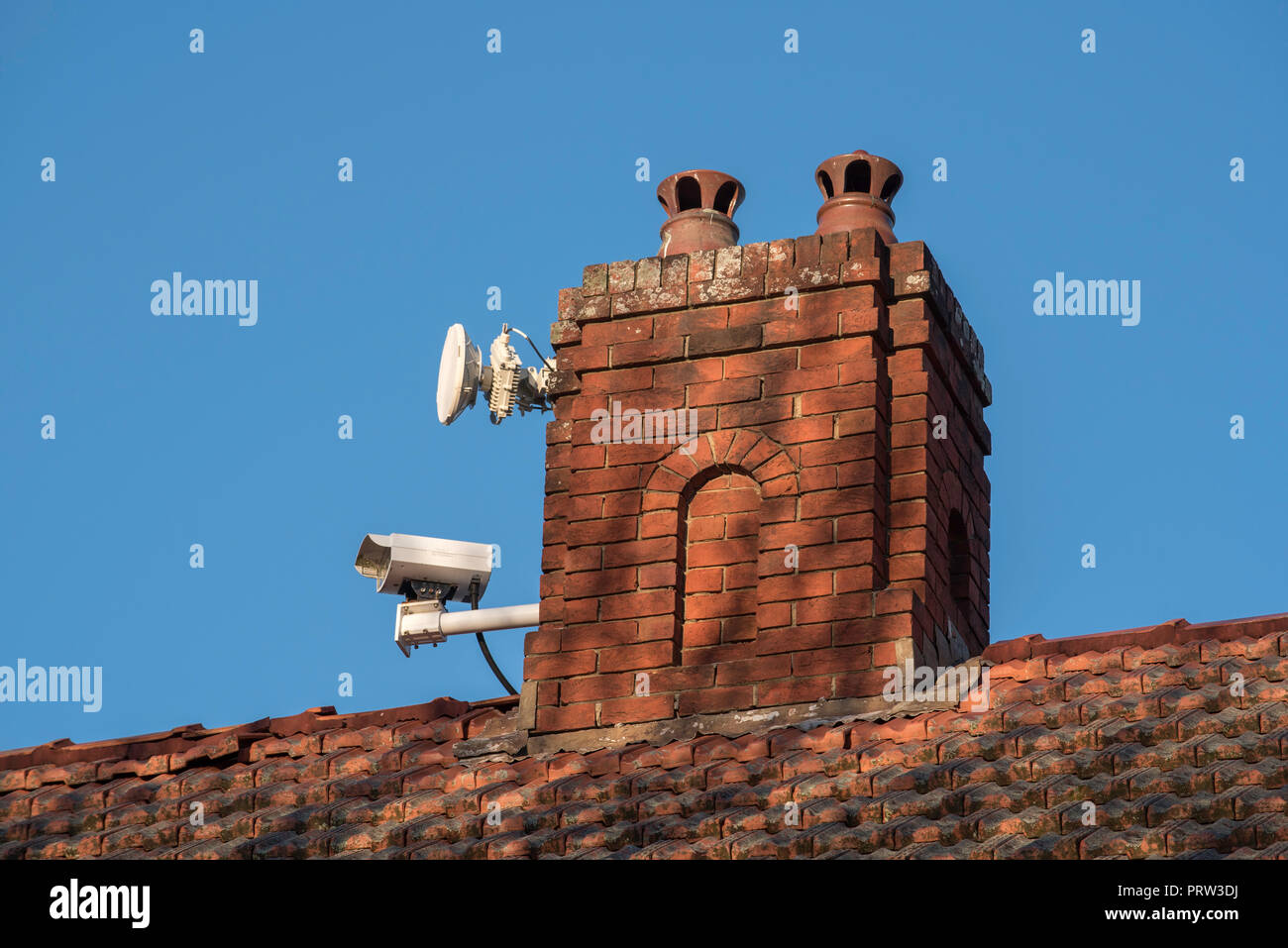 A remote controlled live traffic monitoring camera mounted on a chimney of a home facing the Pacific Highway at Gordon NSW, Australia - Stock Image