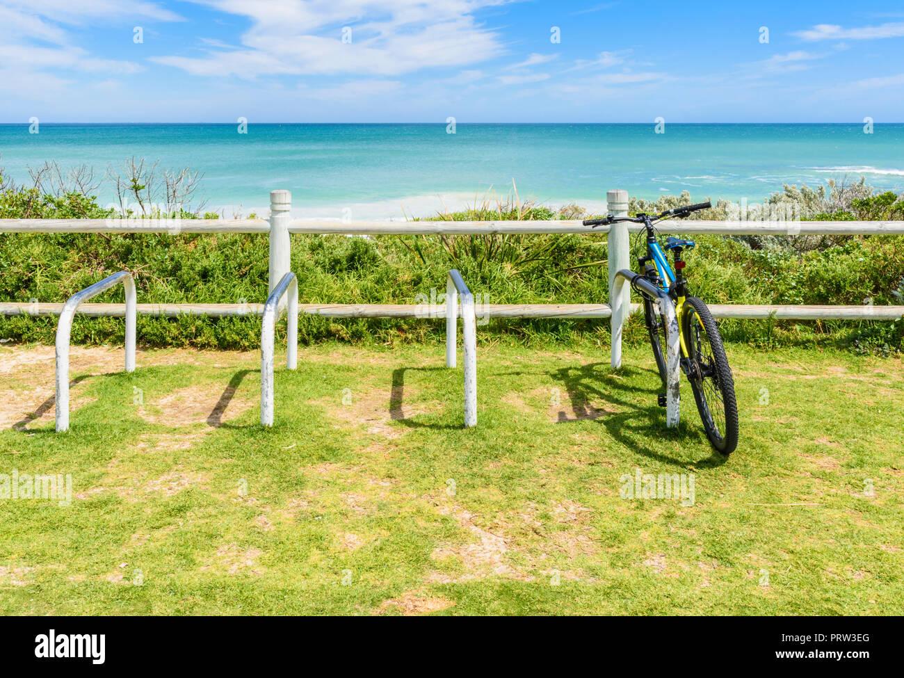 Bike in a cycle rack overlooking Trigg Beach, Trigg, Western Australia Stock Photo