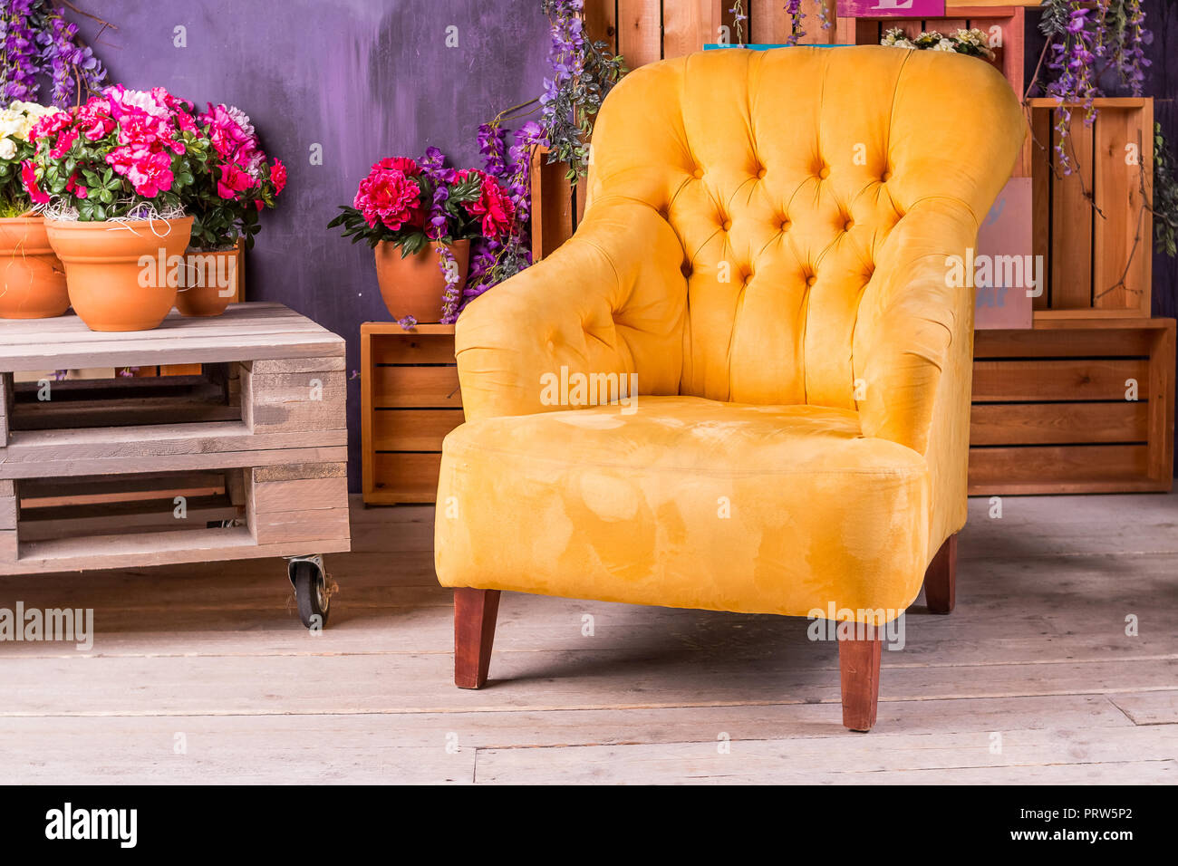 Still life of vintage chair in living roomterrace lounge with comfortable yellow arm chairdivans in a luxury house garden furniture at the patio