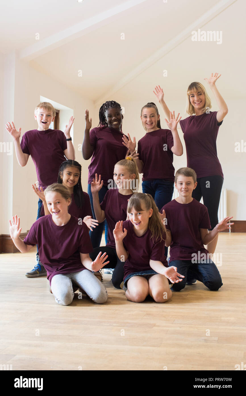 Portrait Of Children And Teacher Enjoying Drama Workshop Together - Stock Image