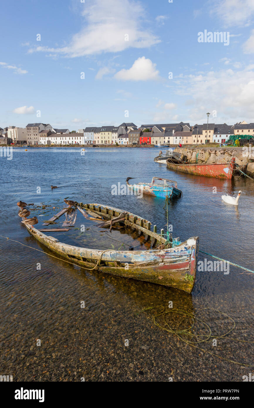 A boat graveyard in River Corrib in the Claddagh area of Galway in Ireland. Stock Photo