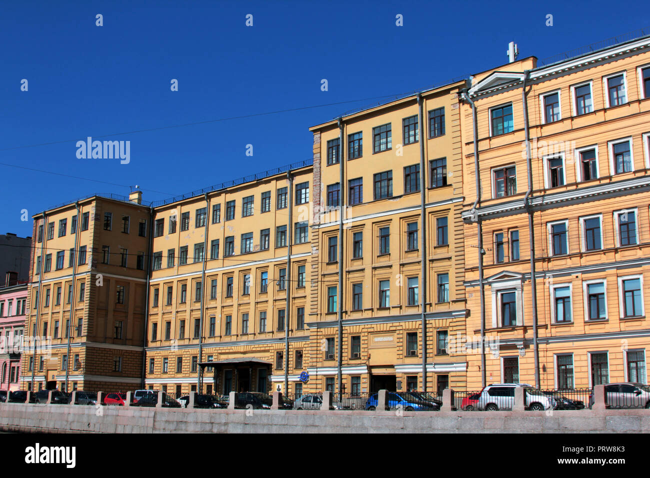 A large, grand, orderly, colourful and pristine façade of a building in St Petersburg, Russia. - Stock Image