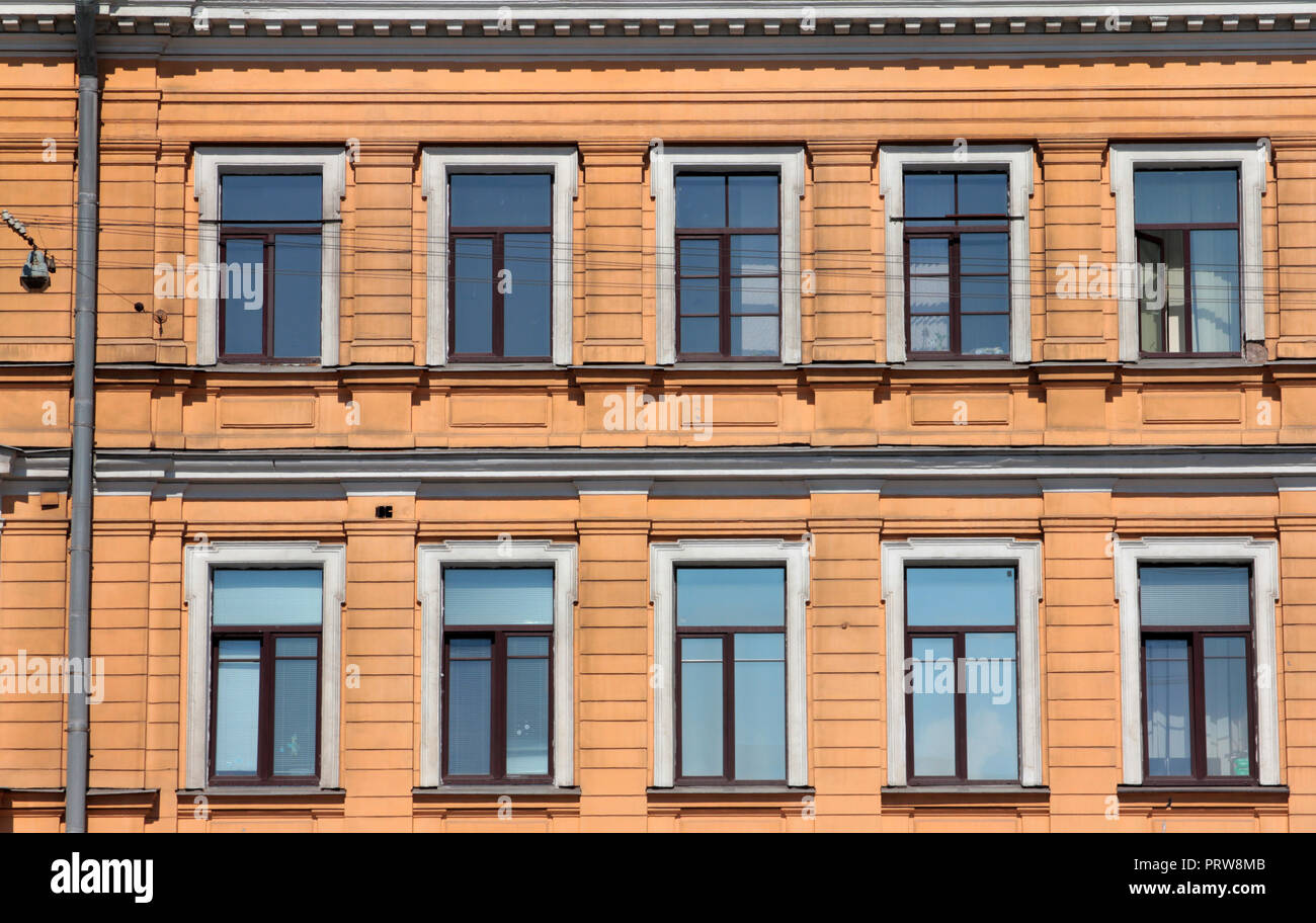 A pristine, ordered and colourful façade of a building in St Petersburg, Russia. - Stock Image