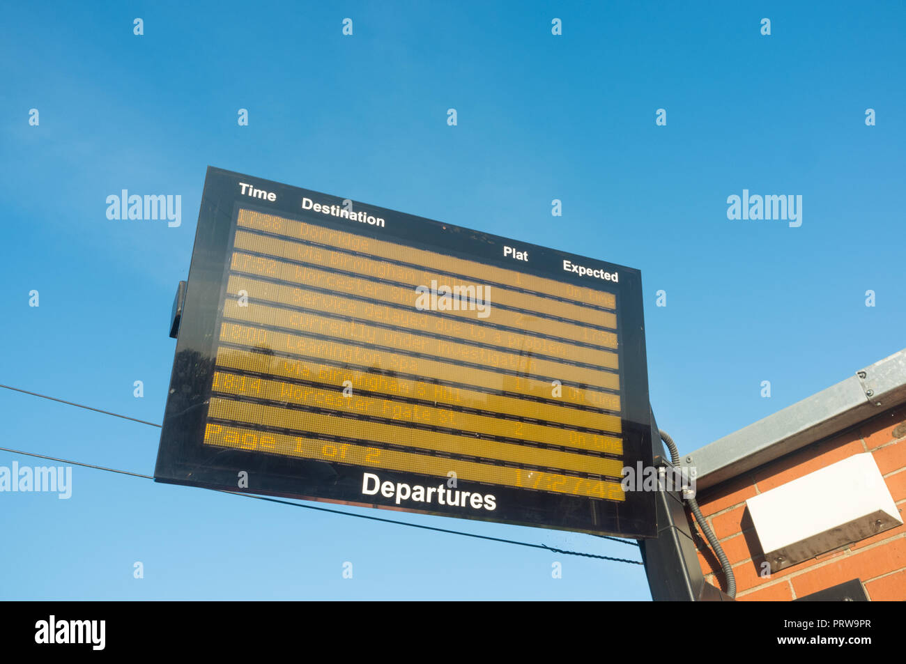 Train departures screen outdoors at a UK railway Station - Stock Image