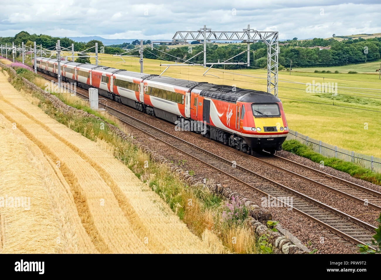 LNER high speed train still in Virgin colours at Park Farm near Linlithgow West Lothian Scotland UK travelling from Inverness to London via Edinburgh - Stock Image