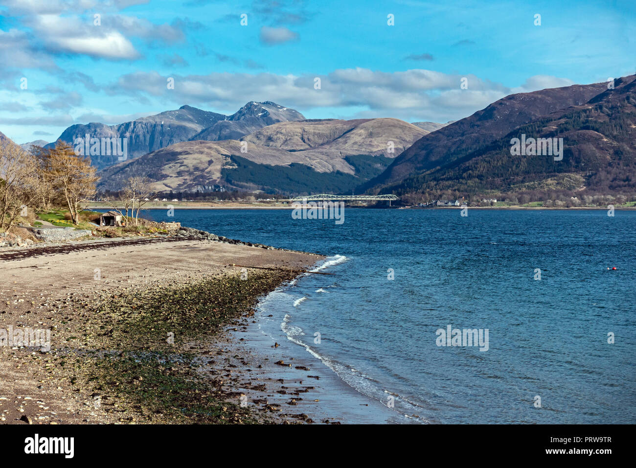 View towards Glencoe mountains from the north shore of Loch Leven at Onich Highland West Highlands Scotland UK - Stock Image