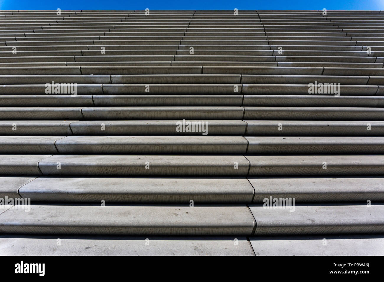 Hamburg , Germany, June 26, 2018: Full Frame Close-Up of Stairs at Landungsbrücken  Against Blue Sky - Stock Image