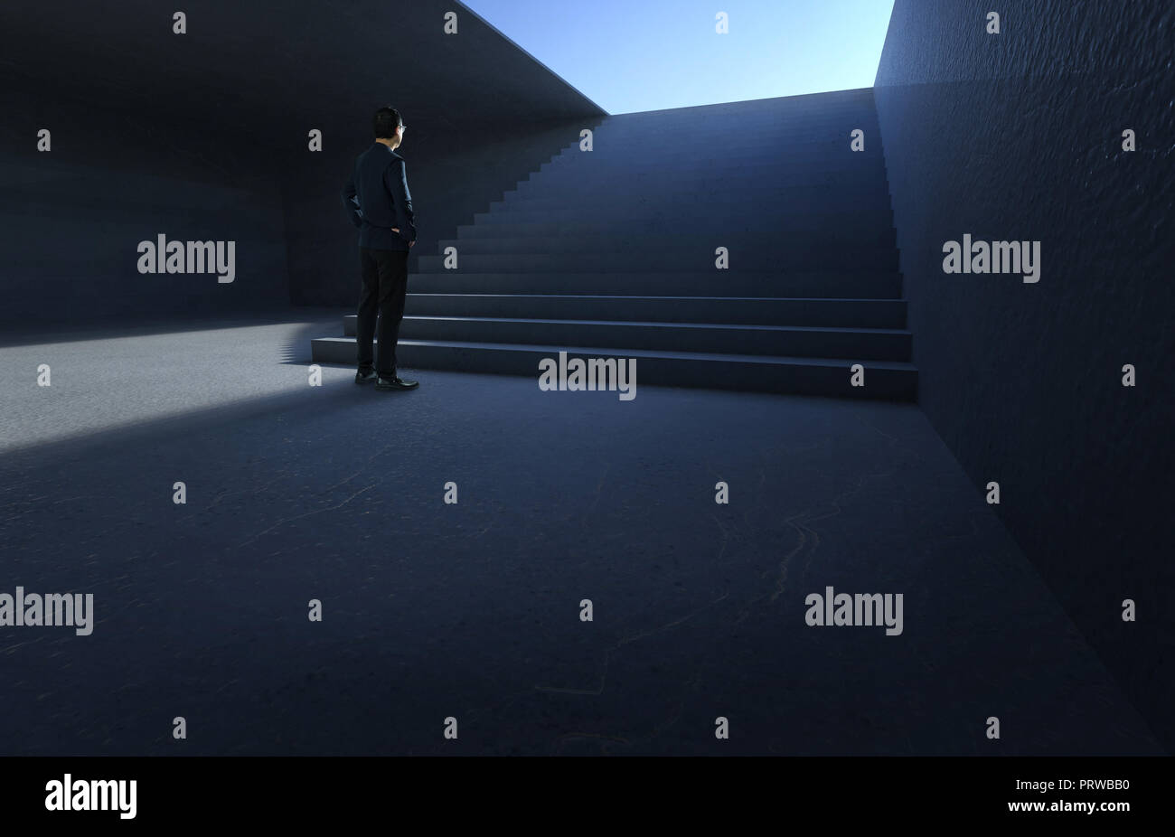 Businessman looking and thinking front of a concrete stairs in the underground . - Stock Image