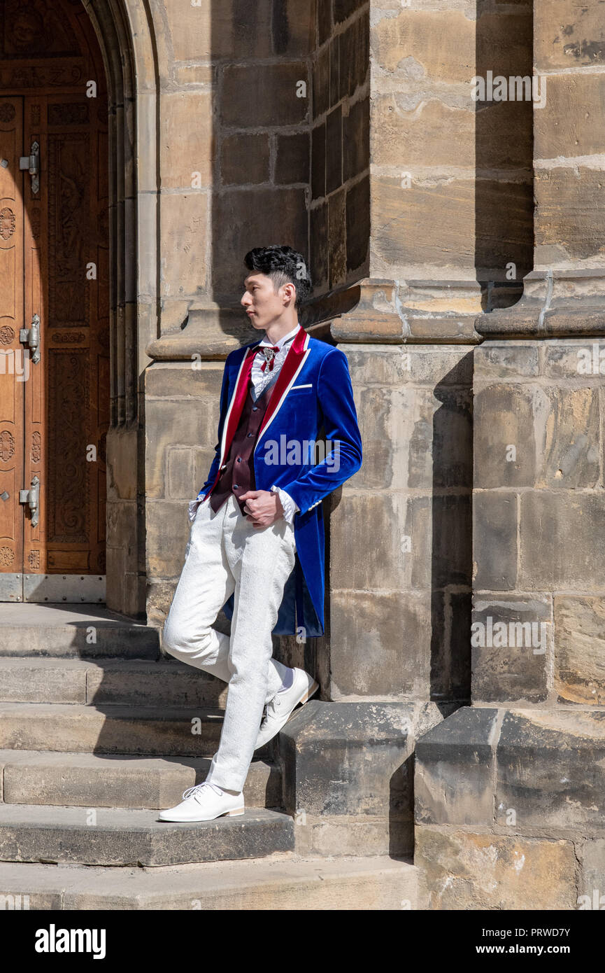 Candid shots of groom posing for wedding photos at St. Vitus Gothic Cathedral in Prague - Stock Image