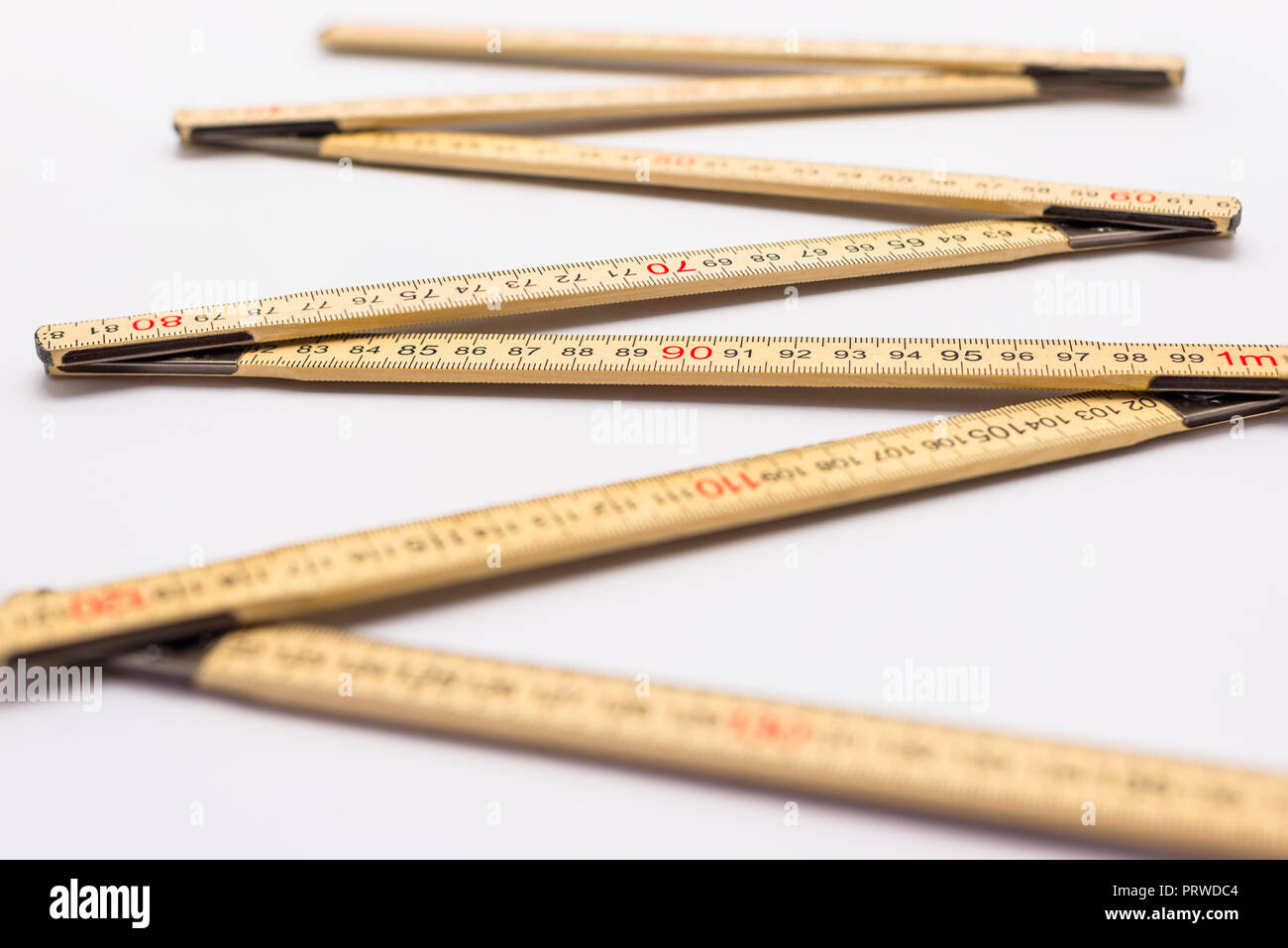 Wooden folding ruler isolated on a white background. - Stock Image