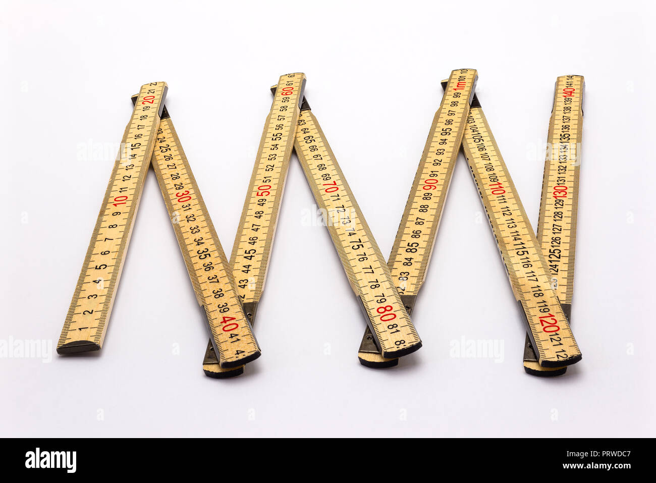 Wooden folding ruler isolated on a white background with a clipping path. - Stock Image