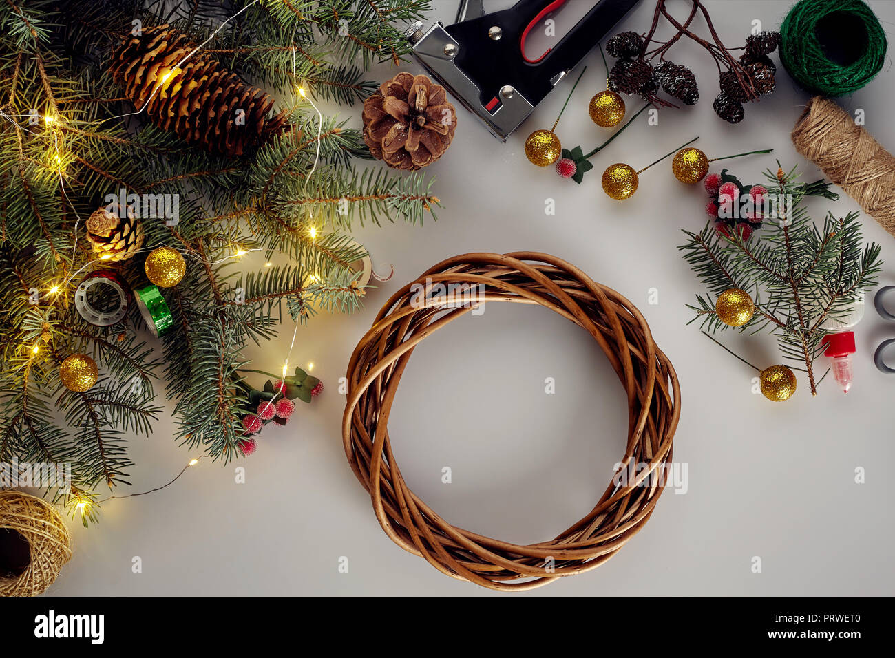 Christmas Background With Decorations Garland And Pine Cones Creating Wreath Made Of Christmas Tree Branches On White Background Stock Photo Alamy