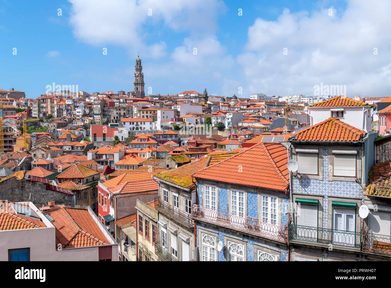 View over the rooftops of the city from the Cathedral, looking towards the Clerigos Tower, Porto, Portugal - Stock Image