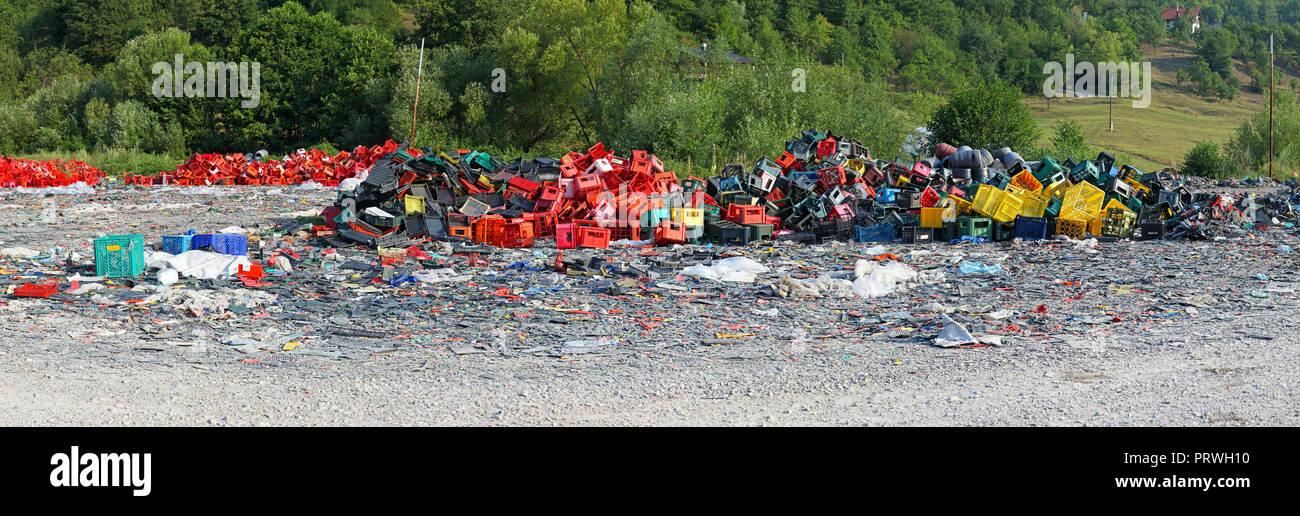 Colorful pile of plastic junk at scrap yard - Stock Image