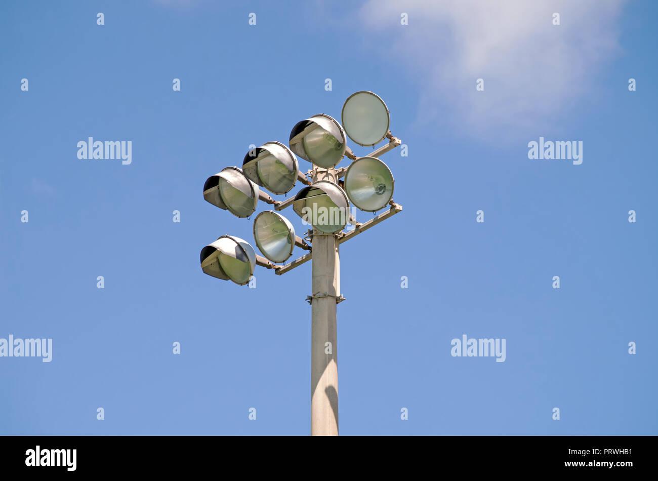 Stadium lights, unlit, against blue sky. Cabaniss football field in Corpus Christi, Texas USA. - Stock Image