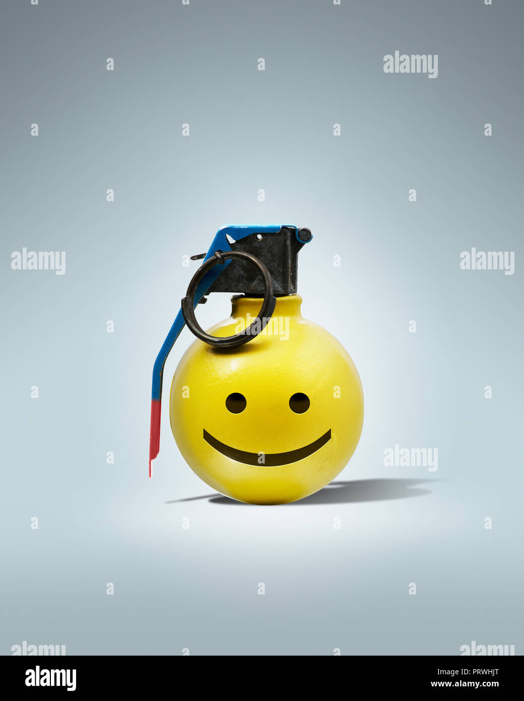 Yellow Round Hand Grenade, Bomb with smile smily face Concept - Stock Image