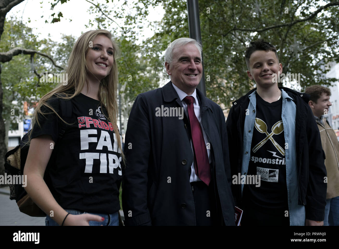 London, Greater London, UK. 5th Oct, 2018. John McDonnell (centre), Labor Member of Parliament seen during the demonstration.Wetherspoons, TGI Fridays, and McDonald's workers rally together in London to demand better working conditions and a fair pay in the hospitality industry. Credit: Andres Pantoja/SOPA Images/ZUMA Wire/Alamy Live News - Stock Image