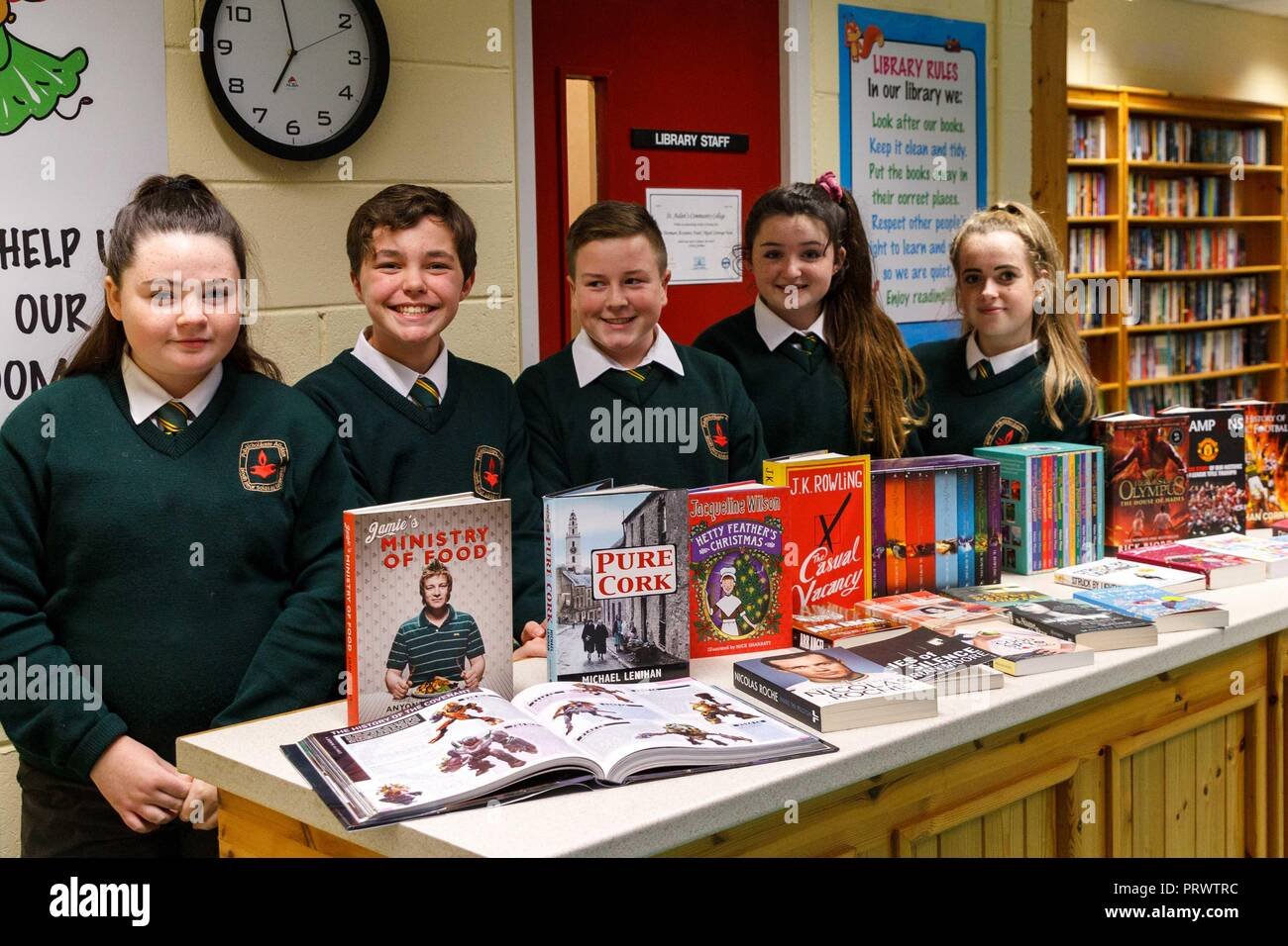 Cork, Ireland. 4th Oct, 2018.   St Aidans Open Night, Cork City. Pictured here (LtoR) are Rebecca Dunne, Ronan O Keeffe, Paul Wall, Lucy Moe and Ciara Greaney showing off some of the books the school libary has to offer. At 7pm this evening St Aidans Community College, Dublin Hill opened its door to give potential students and their families a glimpse into life in St Aidans. Parents and incoming students had a chance to see the various departments throughout the school which opened their doors to show what they had to offer the incoming students. Credit: Damian Coleman/ Alamy Live News. - Stock Image