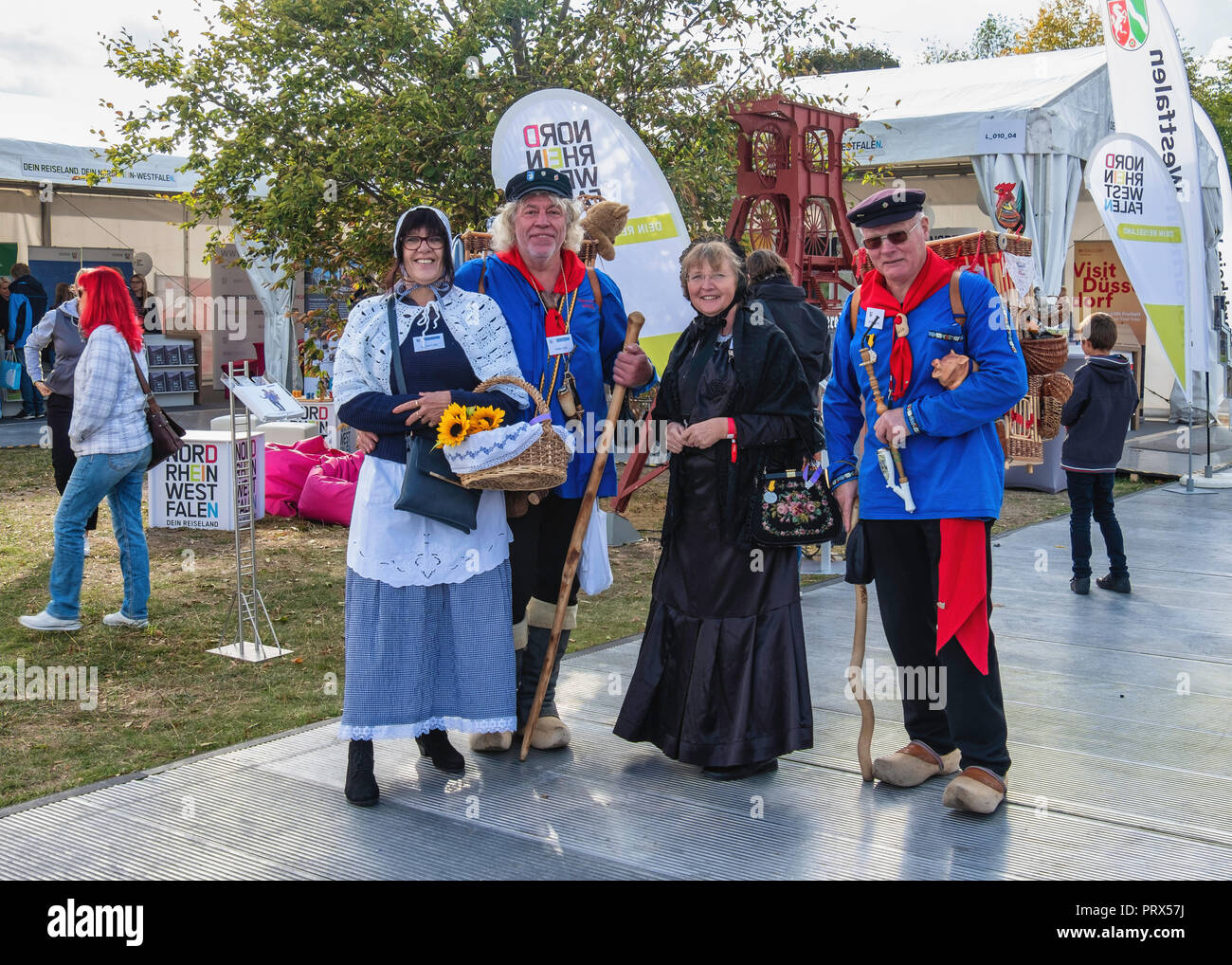 Germany, Berlin, Mitte, 1-3 October 2018. People in Colourful costumes at State of North Rhine Westphalia display on German Unity day.                 - Stock Image