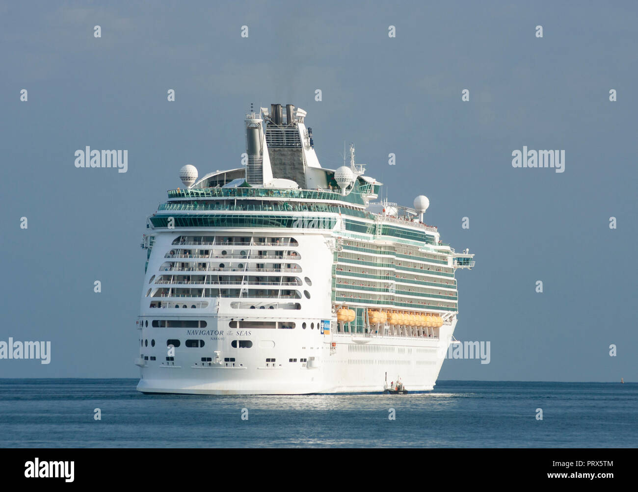 Large cruise (Navigator of the Seas) ship emitting black smoke from funnelNavigator of the Seas cruise ship. - Stock Image