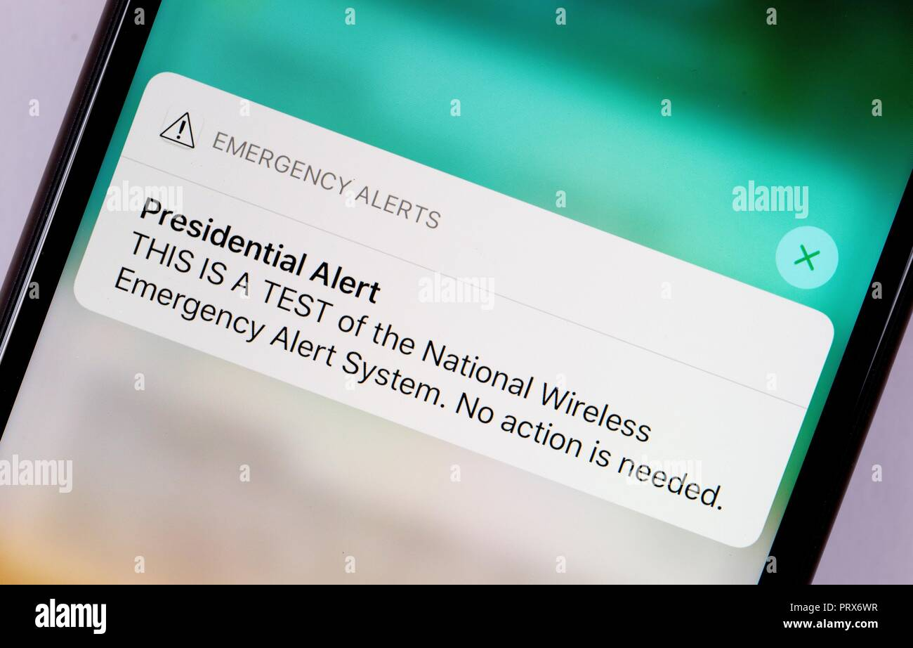 A United States nationwide, text message, Presidential Alert issued October 3, 2018.  The message states: Emergency Alerts: Presidential Alert – THIS  - Stock Image