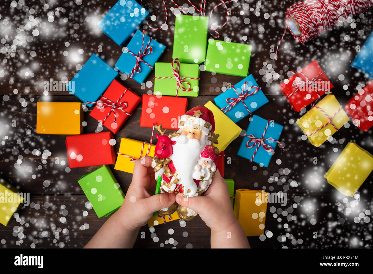 Colorful Christmas Background For Kids.Christmas Magic Two Kids Hands Hold Santa Claus With Hope