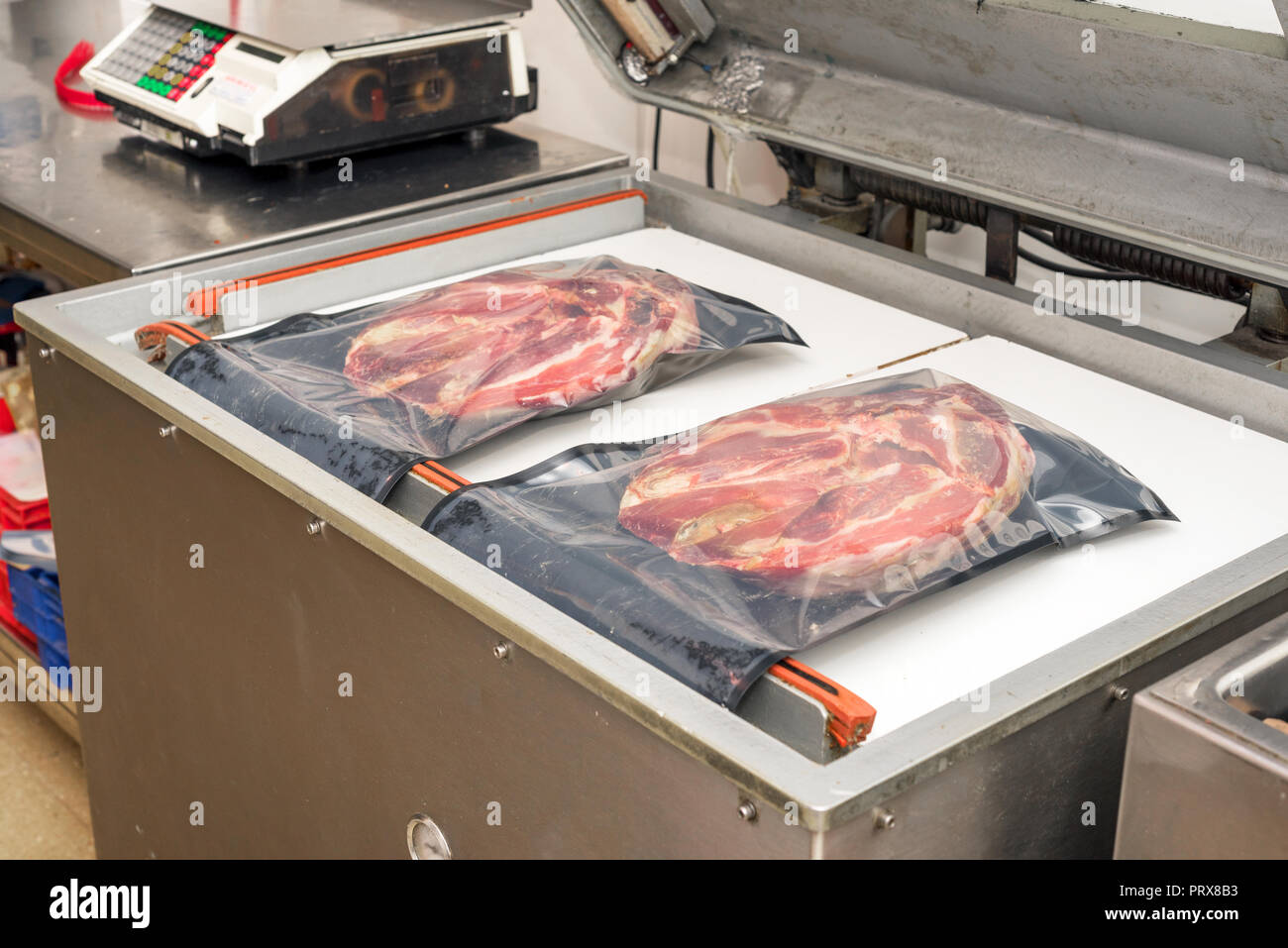 Heat Vacuum sealing machine for meat industry - Stock Image