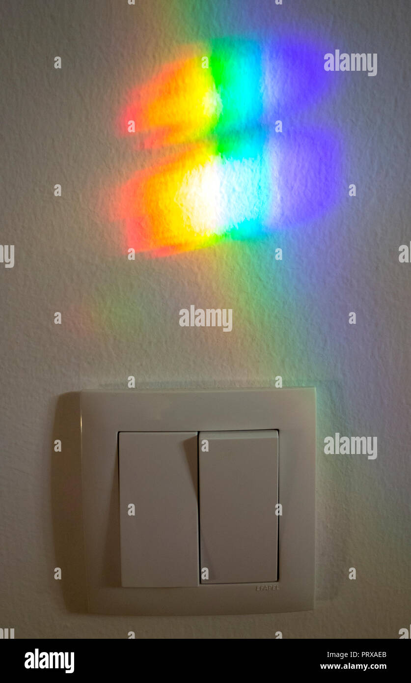 Light refraction on the wall. Spectrum of colors. Light refraction through window glass. Portugal Stock Photo